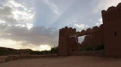 Time lapse footage of sunset ,sunlight rays and the ruins of Ait Ben Haddou Stock Footage