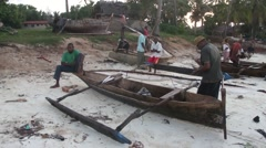 Tanzanian fishermen are repairing a boat Stock Footage