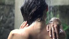 Young naked woman washing sexy body under shower, super slow motion Stock Footage