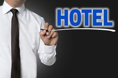 Stock Photo of Hotel is written by businessman background concept
