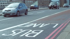 Red London bus drives in bus lane Stock Footage