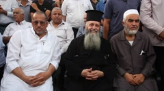 Priest Saleh Khoury of Sakhnin (c) and Islamic Movement leader Sheikh Raed Salah Stock Footage