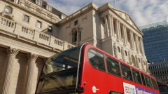 Stock Video Footage of Tilt down the Bank of England with a red bus in front