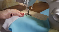 Sewing Process - Women's hands behind her sewing Stock Footage