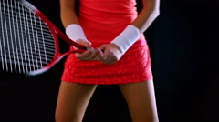 Stock Video Footage of The body of a girl tennis player expecting serving on a black background