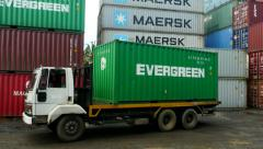 Container Freight Station Evergreen Box going out on a Prime Mover Stock Footage