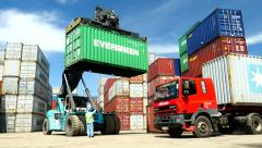 Container Freight Station Evergreen Box on a Stacker & Maersk Box in Foreground Stock Footage