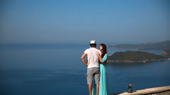 Romantic lovers in love, young couple standing over sea and blue sky background. Stock Footage