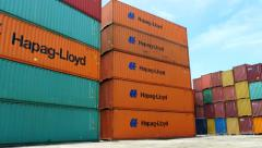 Container Freight Station Hapag Lloyd boxes prominently visible Stock Footage