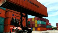 Container Freight Station Hapag Lloyd Box being moved in Close Up - stock footage