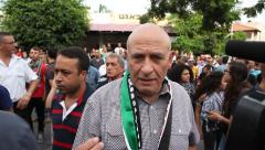 Arab Israeli Member of Knesset Dr Basel Ghattas in anti Israel protest Stock Footage