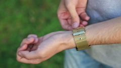 Man clasping his wrist watch Stock Footage