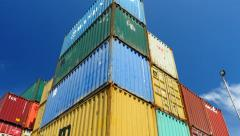 Container Freight Station Multi Coloured Containers against blue sky Stock Footage