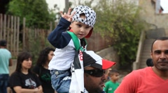 A child waves his hand with the victory sign during anti Israel protest Stock Footage