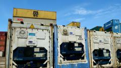 Container Freight Station Reefer Containers against blue sky - stock footage