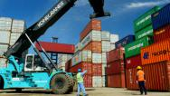 Stock Video Footage of Container Freight Station Stacker working with various branded boxes