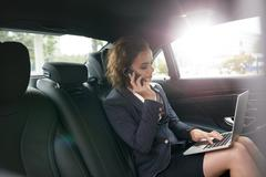 Female entrepreneur working during travelling to office Stock Photos