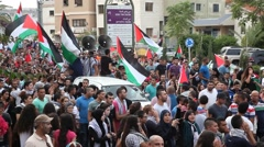Arab Israeli Muslim activists march with PLO flags in anti Israel protest Stock Footage