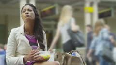 4K Portrait of beautiful young woman eating lunch outdoors in the city Stock Footage
