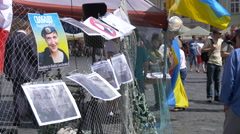 Posters and Ukraine flag in the Old Town Square of Prague Stock Footage