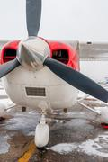 Photo closeup propeller plane in bad weather - stock photo