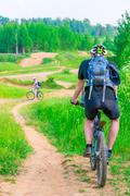 biking on impassability to a nice summer day - stock photo