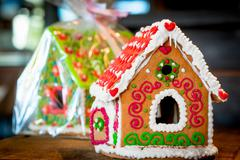 sweet gingerbread house is beautifully decorated for Christmas - stock photo