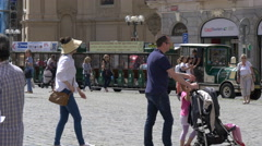 Green city tour train in the Old Town Square of Prague Stock Footage