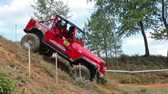 Red off road car is speeding slope Stock Footage