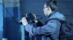 Young male photographer making a photo for stocks Stock Footage