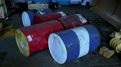 old barrels with gasoline lie on the floor - stock footage