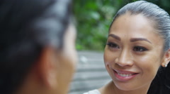 4K Close up portrait 2 beautiful female friends chatting outdoors in the city - stock footage