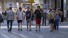 People walking on Havířská Street in Prague Stock Footage
