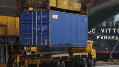 Port - Container Geseaco being lifted onto vessel Stock Footage