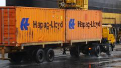 Port - Hapag Lloyd Containers moves out of frame - stock footage
