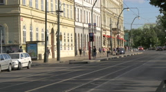 Driving cars on Smetanovo nabrezi, near Faculty of Social Sciences in Prague Stock Footage