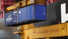 Port - NYK Containers being lifted onto vessel Stock Footage