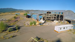 An aerial shot over an abandoned factory mill in Northern California. Stock Footage