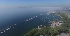 Fly over Fog Aerial Lake ontario and sail boats Stock Footage