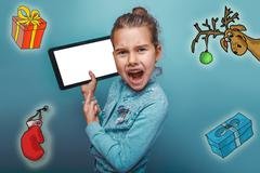 Christmas girl teen Keep your tablet shouts sketch deer gifts mitten new year - stock photo
