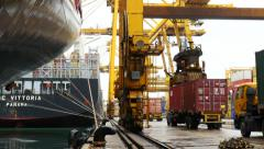 Marine Port Container Movement with vessel in foreground Stock Footage