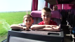Traveling schoolboys in a tour bus, HD footage Stock Footage