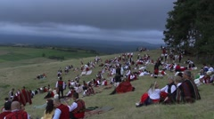 Bulgarian people in costumes of the folk festival in the mountains Stock Footage