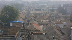 Roofs of houses in the fog Beijing, China Stock Footage