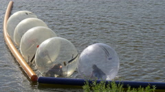 Swimming inside balloons on a summer day, Prague Stock Footage