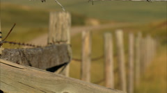 Rack focus of fence with foothills in background - stock footage