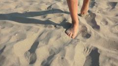 4k Woman walking on sand, footsteps in sand, Front view steadycam shot Stock Footage