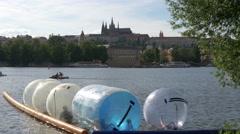People having fun at Vltava River, Prague Stock Footage