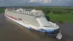 Cruise ship Norwegian Escape on river (Aerial) Stock Footage