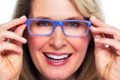 Beautiful elderly lady wearing eyeglasses. Stock Photos